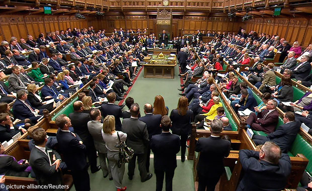 Britain's Prime Minister Theresa May addresses the House of Commons on her government's reaction to the poisoning of former Russian intelligence officer Sergei Skripal and his daughter Yulia in Salisbury, in London,